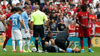 Manchester City's German midfielder Leroy Sane (floor) gets attention for an injury before being substituted during the English FA Community Shield football match between Manchester City and Liverpool at Wembley Stadium in north London on August 4, 2019. (Photo by Ian KINGTON / AFP) / NOT FOR MARKETING OR ADVERTISING USE / RESTRICTED TO EDITORIAL USE