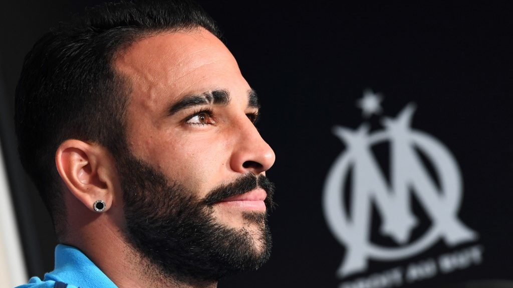 (FILES) This file photo taken on July 19, 2017 in Marseille shows Olympique de Marseille's French defender Adil Rami. - Adil Rami has been sacked by Marseille after skipping training to take part in a reality TV show, according to sources familiar with the matter on August 13, 2019. (Photo by ANNE-CHRISTINE POUJOULAT / AFP)