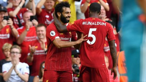 Liverpool's Egyptian midfielder Mohamed Salah celebrates with Liverpool's Dutch midfielder Georginio Wijnaldum (R) after scoring his second goal, Liverpool's third during the English Premier League football match between Liverpool and Arsenal at Anfield in Liverpool, north west England on August 24, 2019. (Photo by Ben STANSALL / AFP) / RESTRICTED TO EDITORIAL USE. No use with unauthorized audio, video, data, fixture lists, club/league logos or 'live' services. Online in-match use limited to 120 images. An additional 40 images may be used in extra time. No video emulation. Social media in-match use limited to 120 images. An additional 40 images may be used in extra time. No use in betting publications, games or single club/league/player publications. /