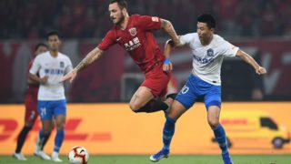 Austrian football player Marko Arnautovic of Shanghai SIPG F.C., middle, chases after the ball in the game against Tianjin TEDA F.C. in the 22nd round match during the 2019 Chinese Football Association Super League (CSL) in Shanghai, China, 14 August 2019.