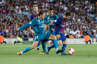 BARCELONA, SPAIN - AUGUST 13: Lionel Messi of FC Barcelona (R) plays against Mateo Kovacic of Real Madrid (L) during the Supercopa de Espana Final 1st Leg match between FC Barcelona and Real Madrid at Camp Nou on August 13, 2017 in Barcelona, Spain. (Photo by Marcio Rodrigo Machado/Power Sport Images/Getty Images,)
