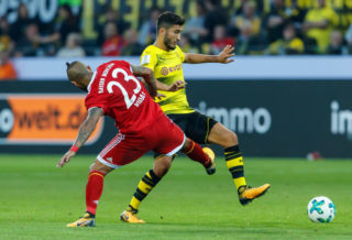 DORTMUND, GERMANY - AUGUST 05: Arturo Erasmo Vidal of Bayern Muenchen and Nuri Sahin of Dortmund battle for the ball during the DFL Supercup 2017 match between Borussia Dortmund and Bayern Muenchen at Signal Iduna Park on August 5, 2017 in Dortmund, Germany. (Photo by TF-Images/TF-Images via Getty Images)