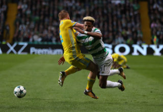 GLASGOW, SCOTLAND - AUGUST 16: Scott Sinclair of Celtic vies with Laszlo Kleinheisler of FC Astana during the UEFA Champions League Qualifying Play-Offs Round First Leg match between Celtic FC and FK Astana at Celtic Park on August 16, 2017 in Glasgow, United Kingdom. (Photo by Ian MacNicol/Getty Images)