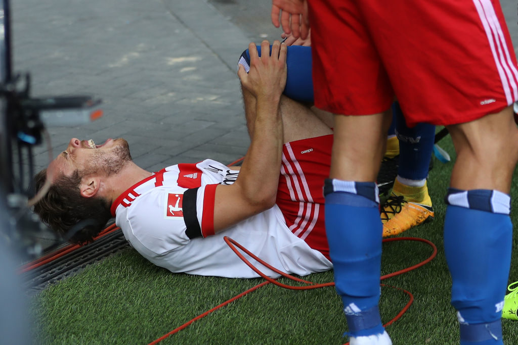 HAMBURG, GERMANY - AUGUST 19:  Nicolai Mueller of Hamburg injure after his scoring the opening goal during the Bundesliga match between Hamburger SV and FC Augsburg at Volksparkstadion on August 19, 2017 in Hamburg, Germany.  (Photo by Oliver Hardt/Bongarts/Getty Images)