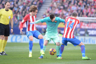 MADRID, SPAIN - FEBRUARY 26:  Lionel Messi, #10 of FC Barcelona and Antoine Griezmann, #7 of Atletico de Madrid and Gabi, #14 of Atletico de Madrid  during The La Liga match between Club Atletico de Madrid v FC Barcelona - La Liga  at  Vicente Calderon on February 26, 2017 in Madrid, Spain. (Photo by Sonia Canada/Getty Images)