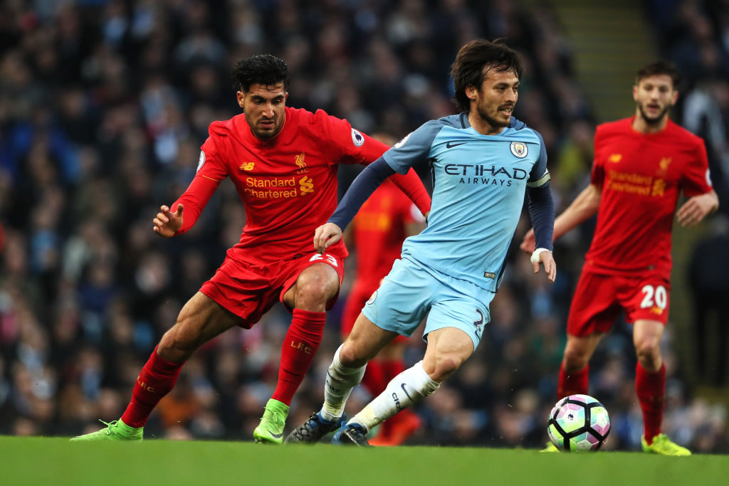 MANCHESTER, ENGLAND - MARCH 19:  David Silva of Manchester City competes with Emre Can of Liverpool during the Premier League match between Manchester City and Liverpool at Etihad Stadium on March 19, 2017 in Manchester, England.  (Photo by Matthew Ashton - AMA/Getty Images)