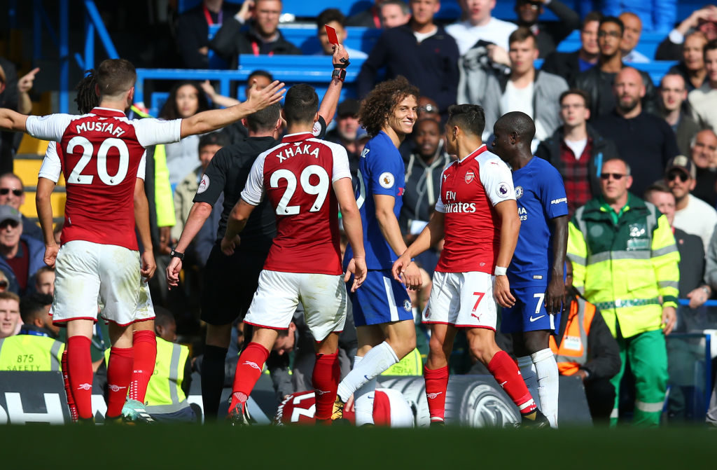 LONDON, ENGLAND - SEPTEMBER 17: David Luiz of Chelsea is shown a red card and sent off during the Premier League match between Chelsea and Arsenal at Stamford Bridge on September 17, 2017 in London, England. (Photo by Catherine Ivill - AMA/Getty Images)