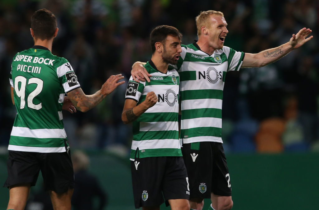 LISBON, PORTUGAL - SEPTEMBER 16:Sporting CP defender Jeremy Mathieu from France celebrates with teammate Sporting CP midfielder Bruno Fernandes from Portugal after scoring a goal during the Primeira Liga match between Sporting CP and CD Tondela at Estadio Jose Alvalade on September 16, 2017 in Lisbon, Portugal.  (Photo by Gualter Fatia/Getty Images)