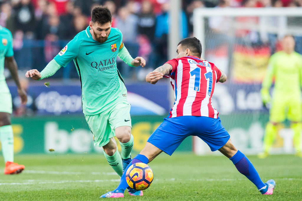 MADRID, SPAIN - FEBRUARY 26: Lionel Andres Messi (l) of FC Barcelona fights for the ball with Angel Correa of Atletico de Madrid during their La Liga match between Atletico de Madrid and FC Barcelona at the Santiago Bernabeu Stadium on 26 February 2017 in Madrid, Spain. (Photo by Power Sport Images/Getty Images)