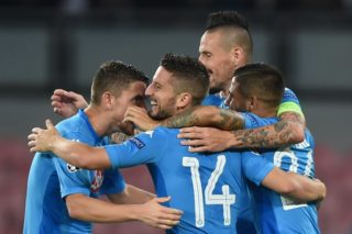 (FILES) This file photo taken on September 26, 2017 shows Napoli's forward from Belgium Dries Mertens (C) celebrates with teammates after scoring during the UEFA Champion's League Group F football match Napoli vs Feyenoord Rotterdam on September 26, 2017 at the San Paolo stadium in Naples.  Manchester City and Napoli are the two most prolific teams in Europe's five major leagues, making the October 17 Champions League encounter at the Etihad Stadium a genuinely mouth-watering prospect. / AFP PHOTO / Filippo MONTEFORTE