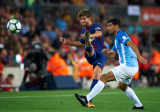 BARCELONA, SPAIN - OCTOBER 21:  Sergi Roberto (L) of Barcelona competes for the ball with Chory Castro of Malaga during the La Liga match between Barcelona and Malaga at Camp Nou on October 21, 2017 in Barcelona, Spain.  (Photo by fotopress/Getty Images)