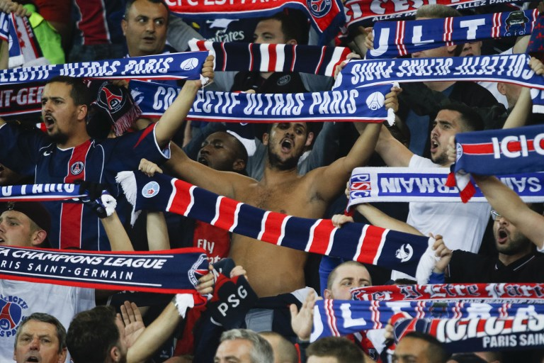 Paris Saint-Germain's fans hold scarves and sing during the UEFA Champions League football match between Paris Saint-Germain and Bayern Munich on September 27, 2017 at the Parc des Princes stadium in Paris. (Photo by Geoffroy Van der Hasselt/NurPhoto)