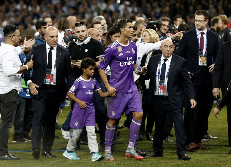 CARDIFF, WALES - JUNE 3: Real Madrid's Cristiano Ronaldo celebrates with his son Cristiano JR. after winning the UEFA Champions League final between Juventus FC and Real Madrid at the National Stadium of Wales in Cardiff, on June 3, 2017. Burak Akbulut / Anadolu Agency
