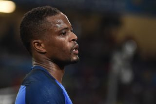 (FILES) This file photo taken on June 15, 2016 shows France's defender Patrice Evra reacting during the Euro 2016 group A football match between France and Albania at the Velodrome stadium in Marseille. Following the November 2, 2017 UEFA Europa League incident in which Evra kicked a Marseille supporter in the face before a match in Guimaraes in Portugal, Evra was banned from all European tournaments until June 30, 2018, the UEFA said on November 10, 2017, as his club of Olympique Marseille (OM) said Evra was leaving the OM. / AFP PHOTO / BERTRAND LANGLOIS