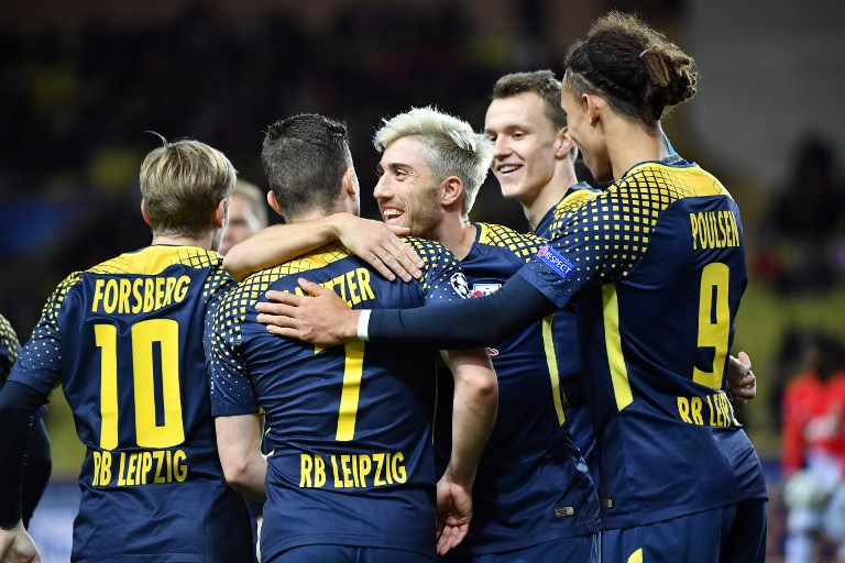 Leipzig's players celebrate after Monaco's Brazilian defender Jemerson scored a goal against his team during the UEFA Champions League group G football match between Monaco and Leipzig at the Louis II stadium, in Monaco, on November 21, 2017. / AFP PHOTO / Bertrand LANGLOIS