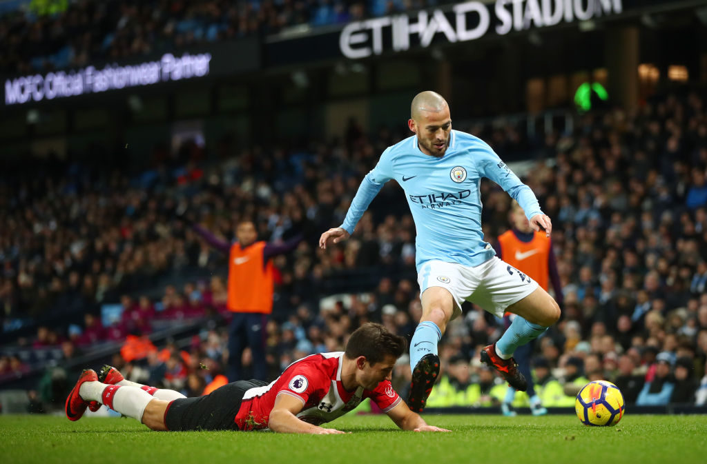 MANCHESTER, ENGLAND - NOVEMBER 29: Cedric Soares of Southampton reacts as David Silva of Manchester City controls the ball during the Premier League match between Manchester City and Southampton at Etihad Stadium on November 29, 2017 in Manchester, England.  (Photo by Clive Brunskill/Getty Images)