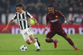 TURIN, ITALY - NOVEMBER 22:  Paulo Dybala of Juventus is tracked by Paulinho of Barcelona during the UEFA Champions League group D match between Juventus and FC Barcelona at Juventus Stadium on November 22, 2017 in Turin, Italy.  (Photo by Michael Steele/Getty Images)