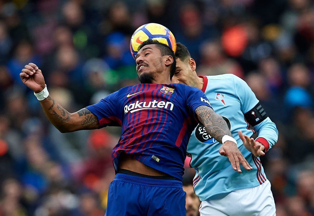 BARCELONA, SPAIN - DECEMBER 02:  Paulinho (L) of Barcelona competes for the ball with Hugo Mallo of Celta during the La Liga match between Barcelona and Celta de Vigo at Camp Nou on December 2, 2017 in Barcelona, Spain.  (Photo by Manuel Queimadelos Alonso/Getty Images)