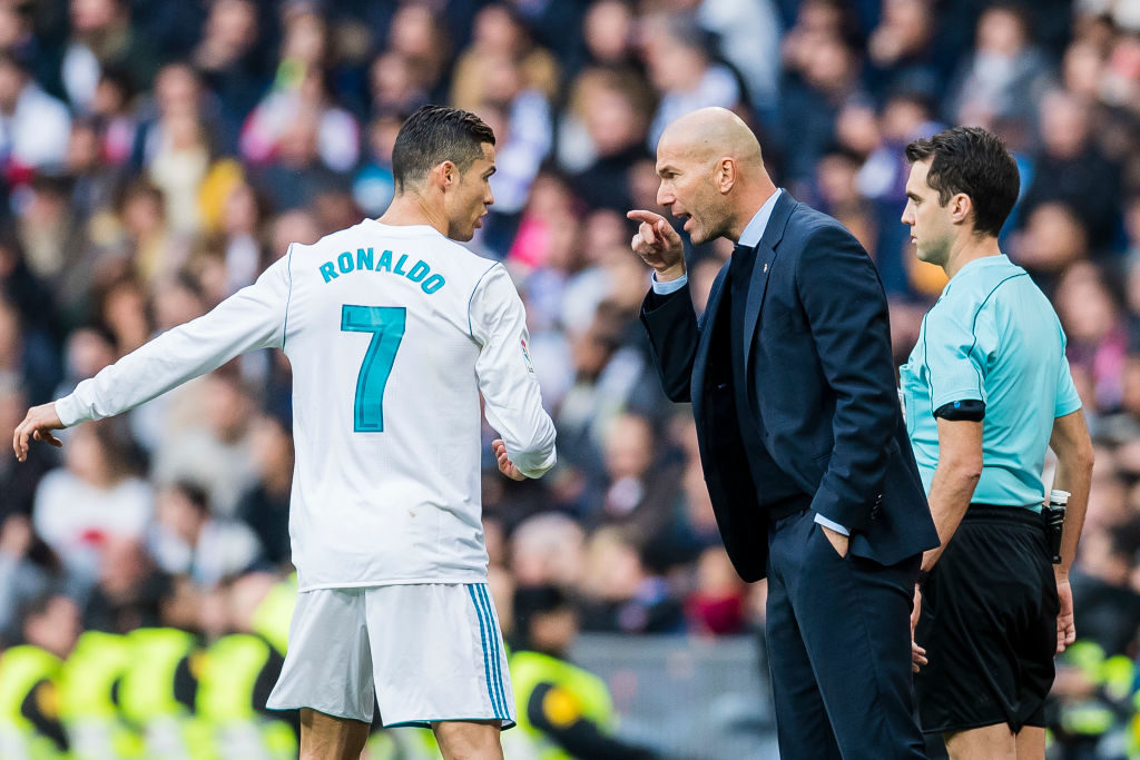 MADRID, SPAIN - DECEMBER 09: Manager Zinedine Zidane (r) of Real Madrid reacts and talks with Cristiano Ronaldo of Real Madrid during the La Liga 2017-18 match between Real Madrid and Sevilla FC at Santiago Bernabeu Stadium on 09 December 2017 in Madrid, Spain. (Photo by Power Sport Images/Getty Images)