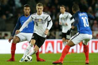 KOLN, GERMANY - NOVEMBER 14: (L-R)  Corentin Tolisso of France, Toni Kroos of Germany during the  International Friendly match between Germany  v France  at the RheinEnergie Stadium on November 14, 2017 in Koln Germany (Photo by Peter Lous/Soccrates/Getty Images)