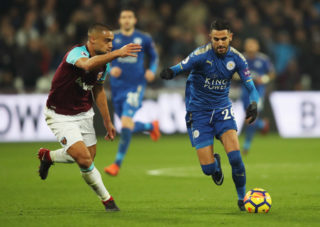LONDON, ENGLAND - NOVEMBER 24:  Riyad Mahrez of Leicester City takes on Winston Reid of West Ham United during the Premier League match between West Ham United and Leicester City at London Stadium on November 24, 2017 in London, England.  (Photo by Julian Finney/Getty Images)