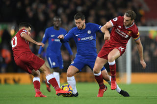 LIVERPOOL, ENGLAND - NOVEMBER 25:  Eden Hazard of Chelsea battles with Philippe Coutinho and Jordan Henderson of Liverpool during the Premier League match between Liverpool and Chelsea at Anfield on November 25, 2017 in Liverpool, England.  (Photo by Shaun Botterill/Getty Images)