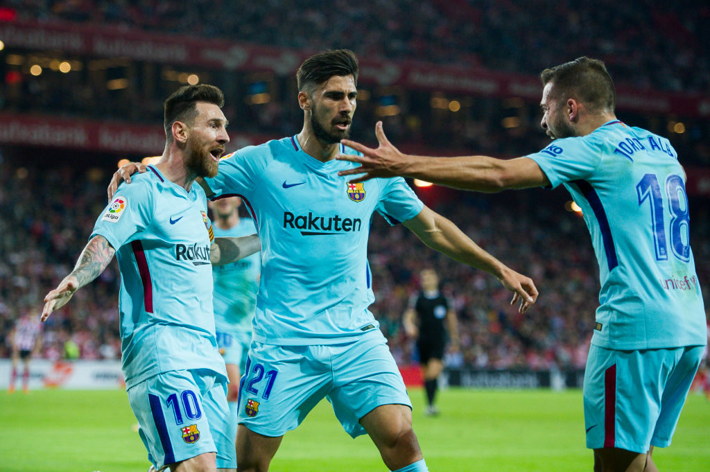 BILBAO, SPAIN - OCTOBER 28:  Lionel Messi of FC Barcelona celebrates with his teammate Andre Gomes and Jordi Alba of FC Barcelona after scoring the opening goal during the La Liga match between Athletic Club Bilbao and FC Barcelona at San Mames Stadium on October 28, 2017 in Bilbao, Spain.  (Photo by Juan Manuel Serrano Arce/Getty Images)