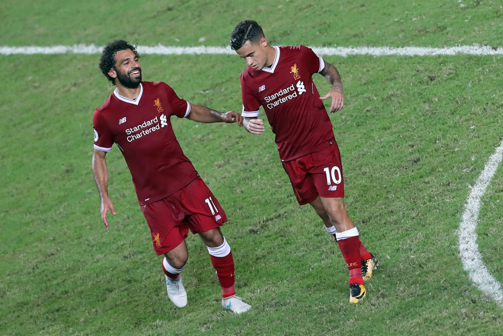 HONG KONG - JULY 22: Philippe Coutinho of Liverpool reels away after scoring while Mohamed Salah runs to embrace him during the Premier League Asia Trophy match between Liverpool FC and Leicester City FC at Hong Kong Stadium on July 22, 2017 in Hong Kong, Hong Kong.  (Photo by Stanley Chou/Getty Images )