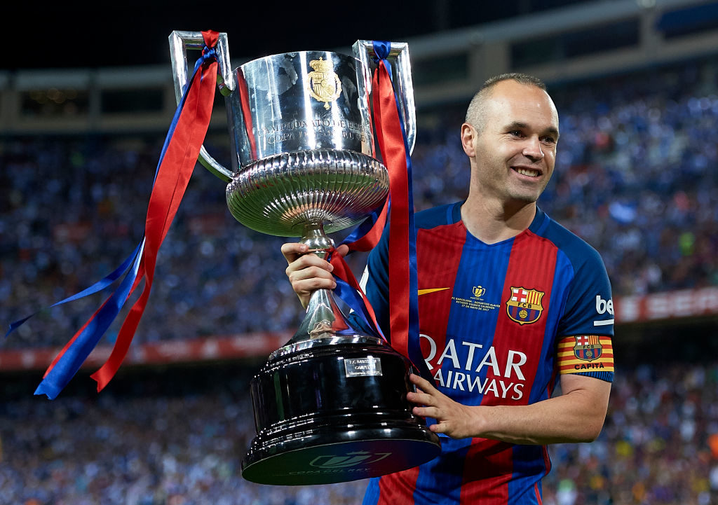 MADRID, SPAIN - MAY 27:  Andres Iniesta of FC Barcelona celebrates with the trophy after winning the Copa Del Rey Final match between FC Barcelona and Deportivo Alaves at Vicente Calderon stadium on May 27, 2017 in Madrid, Spain.  (Photo by fotopress/Getty Images)