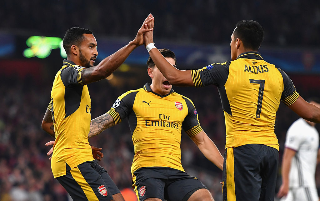 LONDON, ENGLAND - SEPTEMBER 28:  Theo Walcott of Arsenal ceclebrates with team-mates Alexis Sanchez and Hector Bellerin after scoring the opening goal during the UEFA Champions League group A match between Arsenal FC and FC Basel 1893 at the Emirates Stadium on September 28, 2016 in London, England.  (Photo by Mike Hewitt/Getty Images)