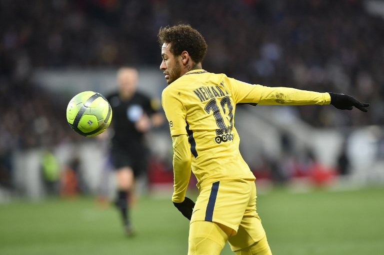 Paris Saint-Germain's Brazilian forward Neymar Jr eyes the ball during the French L1 football match between Toulouse (TFC) and Paris Saint-Germain (PSG) on February 10, 2018 at the Municipal stadium in Toulouse.  / AFP PHOTO / REMY GABALDA