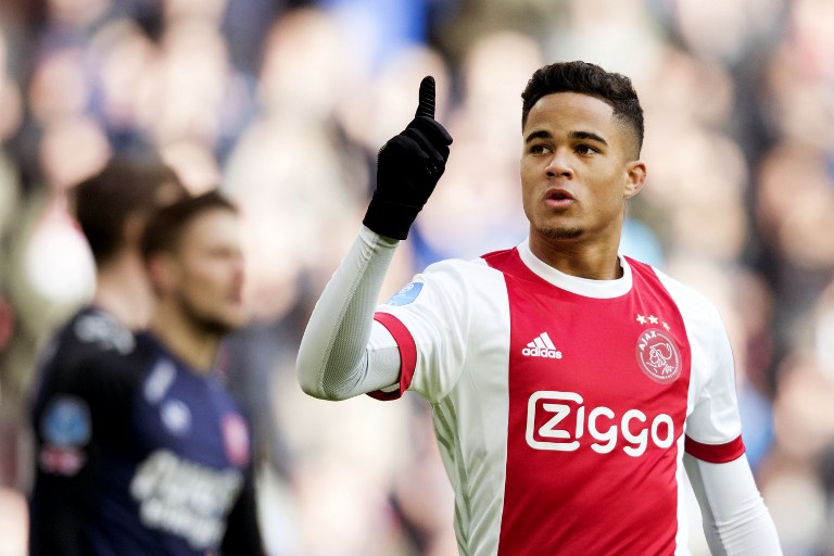 Ajax Amsterdam's midfielder Justin Kluivert reacts after opening the scoring during the Dutch Eredivisie soccer match between Ajax Amsterdam and FC Twente Enschede, in Amsterdam on February 11, 2018.  / AFP PHOTO / ANP / Olaf KRAAK / Netherlands OUT