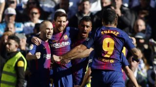 """Barcelona's Argentinian forward Lionel Messi (2L) celebrates with Barcelona's Spanish midfielder Andres Iniesta, Barcelona's Brazilian midfielder Paulinho and Barcelona's Uruguayan forward Luis Suarez after scoring during the Spanish League """"Clasico"""" football match Real Madrid CF vs FC Barcelona at the Santiago Bernabeu stadium in Madrid on December 23, 2017.  / AFP PHOTO / OSCAR DEL POZO"""