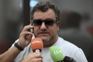 Italian-born Dutch football agent Mino Raiola speaks to journalists on September 2, 2016 during presentation of Nice's football club new signings at the Allianz Riviera stadium in Nice, southeastern France. / AFP PHOTO / VALERY HACHE