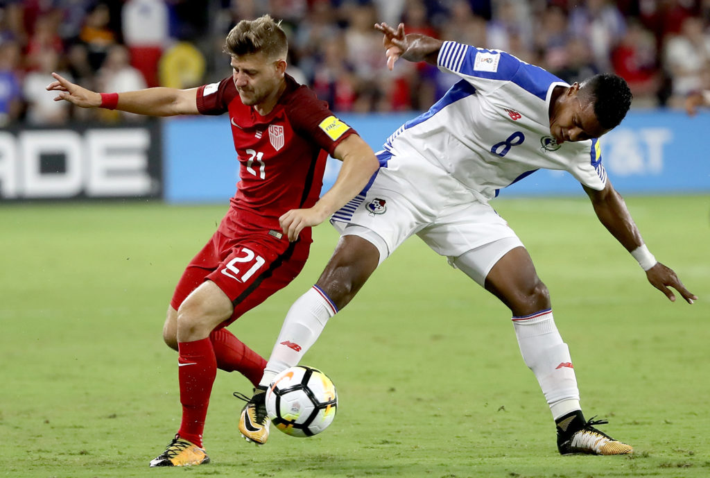 ORLANDO, FL - OCTOBER 06: Paul Arriola #21 of the United States drives past Edgar Barcenas #8 of Panama during the final round qualifying match for the 2018 FIFA World Cup at Orlando City Stadium on October 6, 2017 in Orlando, Florida.   Sam Greenwood/Getty Images/AFP