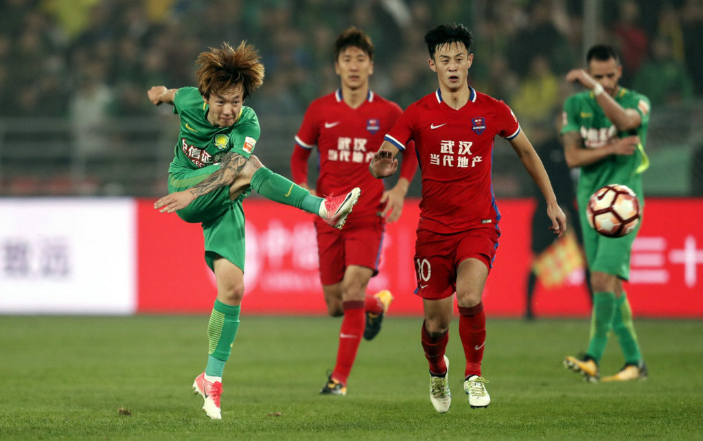 BEIJING, CHINA - OCTOBER 25:  Piao cheng #8 of Beijing Guoan reacts during the Chinese Super League match between  Beijing Guoan FC and ChongQing Dangdai Lifan FC at Beijing Workers Stadium on October 25, 2017 in Beijing, China.  (Photo by XIN LI/Getty Images)