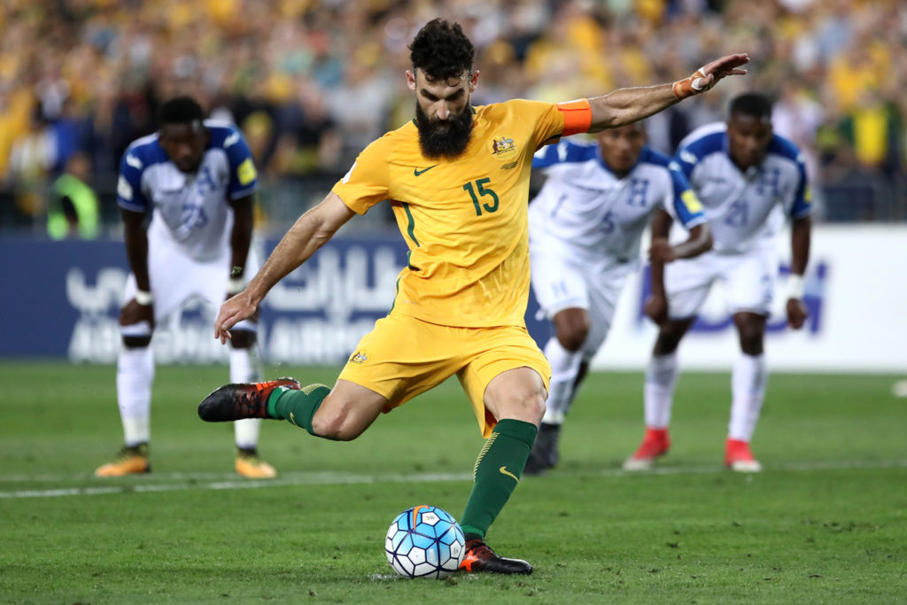 SYDNEY, AUSTRALIA - NOVEMBER 15:  Mile Jedinak of Australia kicks a penalty goal during the 2018 FIFA World Cup Qualifiers Leg 2 match between the Australian Socceroos and Honduras at ANZ Stadium on November 15, 2017 in Sydney, Australia.  (Photo by Cameron J Spencer/Getty Images)