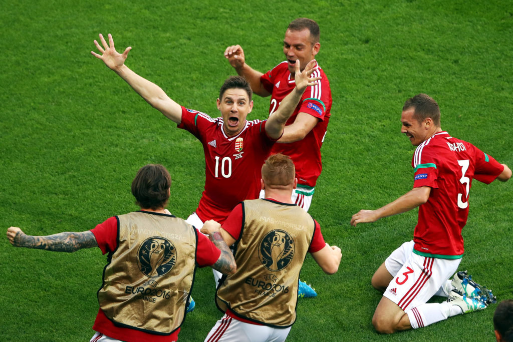 LYON, FRANCE - JUNE 22:  Zoltan Gera (2nd L) of Hungary celebrates scoring his team's first goal with his team mates during the UEFA EURO 2016 Group F match between Hungary and Portugal at Stade des Lumieres on June 22, 2016 in Lyon, France.  (Photo by Clive Brunskill/Getty Images)