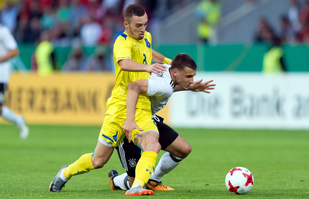 OSNABRUECK, GERMANY - SEPTEMBER 05: Florent Hasani of Kosovo und Maximilian Eggestein of Germany battle for the ball during the U21 - UEFA 2018 EM Qualifying match between Germany and Kosovo at the Stadion Bremer Bruecken in Osnabrueck, Germany on September 05, 2017. (Photo by TF-Images/TF-Images via Getty Images)