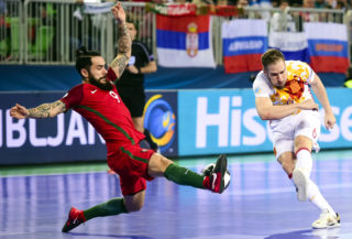 Portugal's Joao Matos blocks a shot by Spain's Solano during the European Futsal Championship final match between Portugal and Spain at Arena Stozice in Ljubljana, Slovenia on February 10, 2018. / AFP PHOTO / Jure Makovec