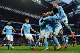 Manchester City's Portuguese midfielder Bernardo Silva (C) celebrates with tammates scoring the opening goal during the English Premier League football match between Manchester City and Chelsea at the Etihad Stadium in Manchester, north west England on March 4, 2018. / AFP PHOTO / Anthony Devlin / RESTRICTED TO EDITORIAL USE. No use with unauthorized audio, video, data, fixture lists, club/league logos or 'live' services. Online in-match use limited to 75 images, no video emulation. No use in betting, games or single club/league/player publications.  /
