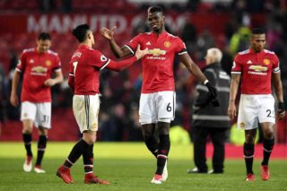 Manchester United's Chilean striker Alexis Sanchez (L) shakes hands with Manchester United's French midfielder Paul Pogba (R) at the end of the English Premier League football match between Manchester United and Huddersfield Town at Old Trafford in Manchester, north west England, on February 3, 2018. / AFP PHOTO / Paul ELLIS / RESTRICTED TO EDITORIAL USE. No use with unauthorized audio, video, data, fixture lists, club/league logos or 'live' services. Online in-match use limited to 75 images, no video emulation. No use in betting, games or single club/league/player publications.  /