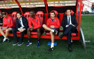 (From 2L) Paris Saint-Germain's Brazilian assistant sporting director Maxwell, French deputy coach Zoumana Camara, Spanish deputy coach Juan Carlos Carcedo and Spanish headcoach Unai Emery sit on the bench prior to the French L1 football match between Dijon (DFCO) and Paris Saint-Germain (PSG) at the Gaston Gerard Stadium in Dijon, central France, on October 14, 2017.  / AFP PHOTO / FRANCK FIFE