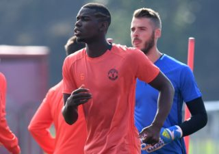 Manchester United's French midfielder Paul Pogba (L) and Manchester United's Spanish goalkeeper David de Gea attend a team training session at their Carrington Training Centre in Manchester, north west England on September 14, 2016. Manchester United are set to play Feyenoord Rotterdam in a UEFA Europa League group A match on September 15. / AFP PHOTO / PAUL ELLIS