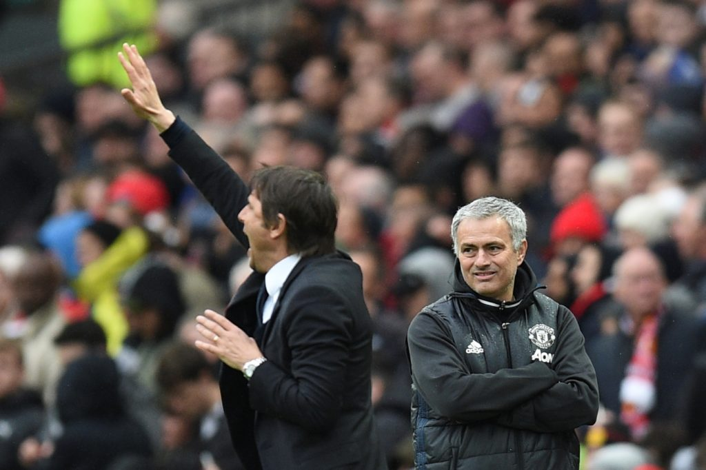 Manchester United's Portuguese manager Jose Mourinho (R) looks on as Chelsea's Italian head coach Antonio Conte (L) gestures during the English Premier League football match between Manchester United and Chelsea at Old Trafford in Manchester, north west England, on April 16, 2017. / AFP PHOTO / Oli SCARFF / RESTRICTED TO EDITORIAL USE. No use with unauthorized audio, video, data, fixture lists, club/league logos or 'live' services. Online in-match use limited to 75 images, no video emulation. No use in betting, games or single club/league/player publications.  /
