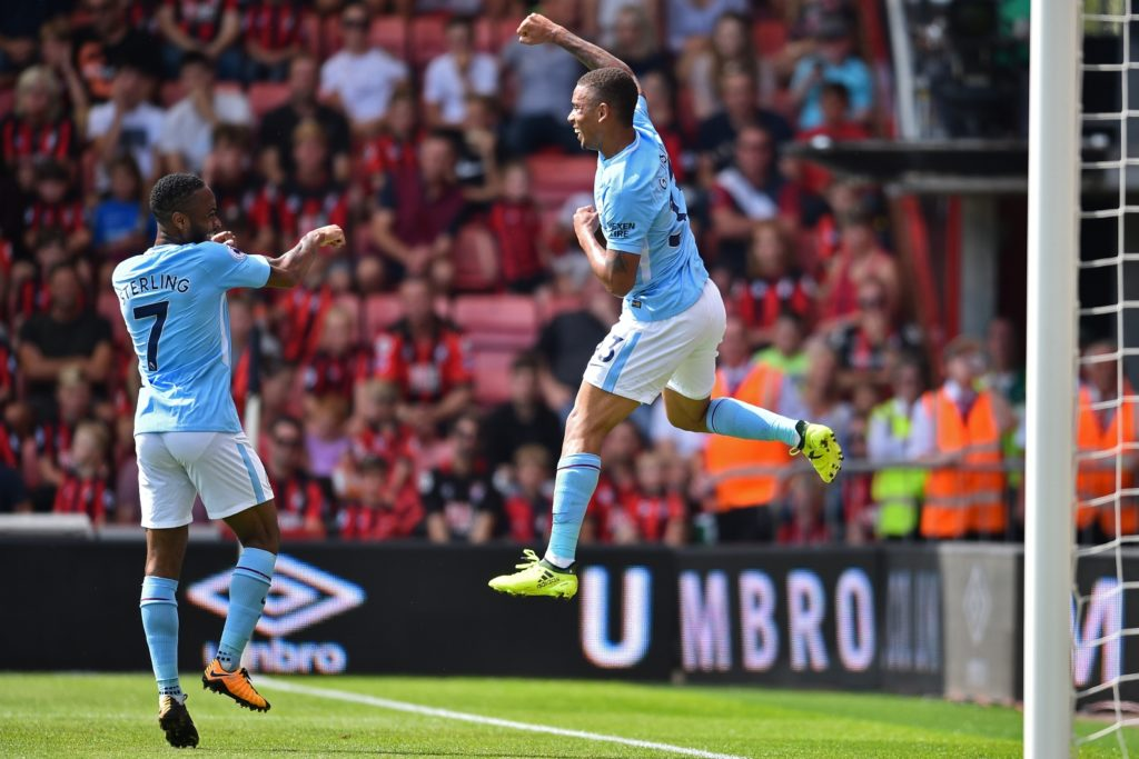 Manchester City's Brazilian striker Gabriel Jesus (R) celebrates with Manchester City's English midfielder Raheem Sterling after scoring their first goal during the English Premier League football match between Bournemouth and Manchester City at the Vitality Stadium in Bournemouth, southern England on August 26, 2017. / AFP PHOTO / Glyn KIRK / RESTRICTED TO EDITORIAL USE. No use with unauthorized audio, video, data, fixture lists, club/league logos or 'live' services. Online in-match use limited to 75 images, no video emulation. No use in betting, games or single club/league/player publications.  /