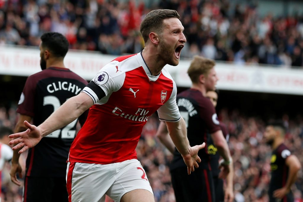 Arsenal's German defender Shkodran Mustafi celebrates after scoring their second goal during the English Premier League football match between Arsenal and Manchester City at The Emirates in London, on April 2, 2017. / AFP PHOTO / IKIMAGES / Ian KINGTON / RESTRICTED TO EDITORIAL USE. No use with unauthorized audio, video, data, fixture lists, club/league logos or 'live' services. Online in-match use limited to 45 images, no video emulation. No use in betting, games or single club/league/player publications.