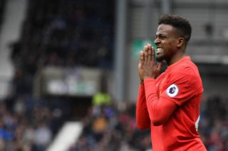 Liverpool's Belgian striker Divock Origi gestures during the English Premier League football match between West Bromwich Albion and Liverpool at The Hawthorns stadium in West Bromwich, central England, on April 16, 2017.  / AFP PHOTO / Justin TALLIS / RESTRICTED TO EDITORIAL USE. No use with unauthorized audio, video, data, fixture lists, club/league logos or 'live' services. Online in-match use limited to 75 images, no video emulation. No use in betting, games or single club/league/player publications.  /