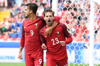 Portugal's midfielder Adrien Silva (R) celebrates with Portugal's forward Andre Silva after scoring his team's winning goal during the 2017 FIFA Confederations Cup third place football match between Portugal and Mexico at the Spartak Stadium in Moscow on July 2, 2017. / AFP PHOTO / Yuri KADOBNOV