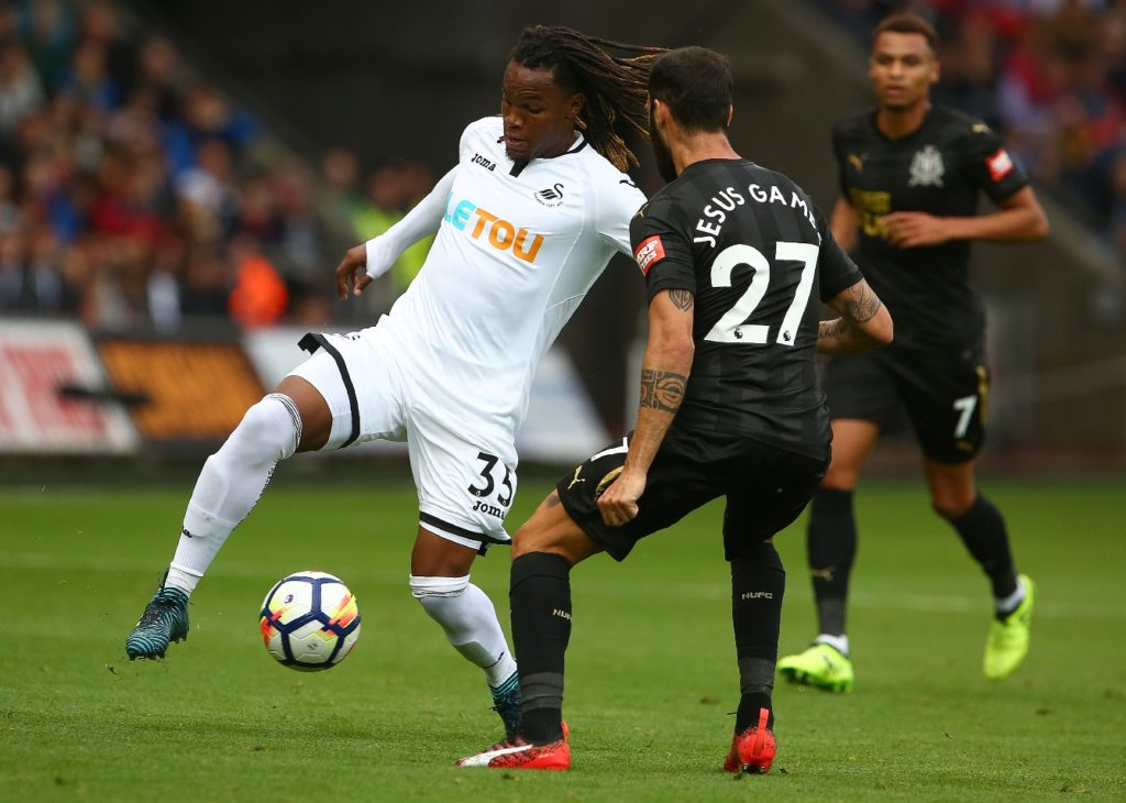 Swansea City's Portuguese midfielder Renato Sanches (L) takes on Newcastle United's Spanish defender Jesus Gamez (R) during the English Premier League football match between Swansea City and Newcastle United at The Liberty Stadium in Swansea, south Wales on September 10, 2017. / AFP PHOTO / GEOFF CADDICK / RESTRICTED TO EDITORIAL USE. No use with unauthorized audio, video, data, fixture lists, club/league logos or 'live' services. Online in-match use limited to 75 images, no video emulation. No use in betting, games or single club/league/player publications.  /